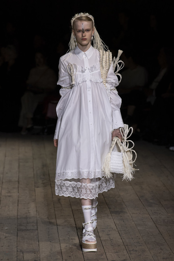 Tulle lace fairy wearing Simone Rocha